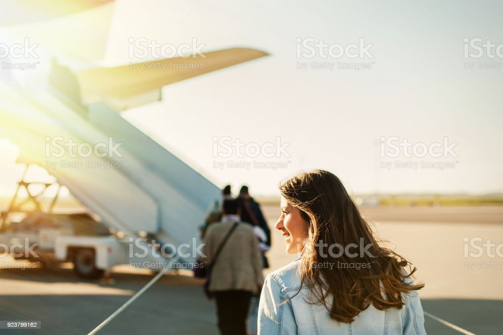 Pretty woman getting in to plane royalty-free stock photo