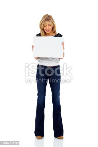 157609352 istock photo Pretty woman holding blank signboard over white 180756239