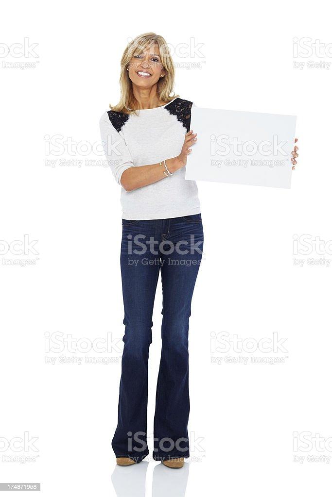 Pretty woman holding empty billboard royalty-free stock photo
