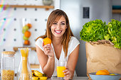 istock Pretty woman holding glass with tasty juice 1249115936
