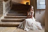 Pretty serene woman in a castel,