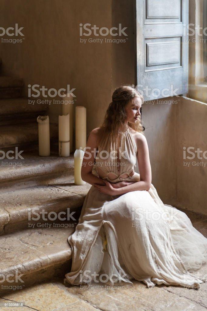 Pretty woman in a castle stock photo