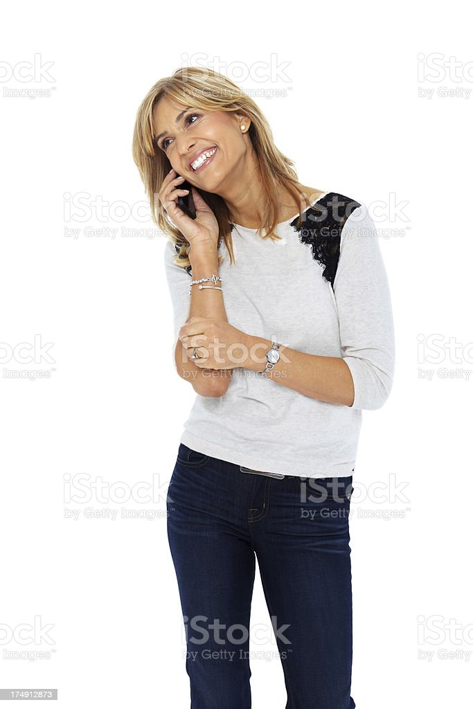 Pretty woman in conversation on cell phone smiling royalty-free stock photo