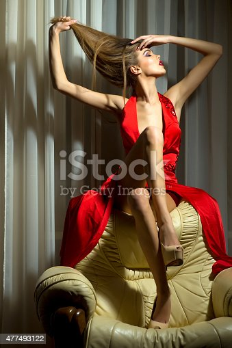 578573556istockphoto Pretty woman in red dress 477493122