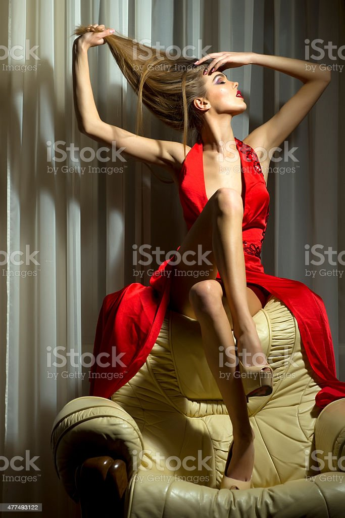 Pretty woman in red dress stock photo