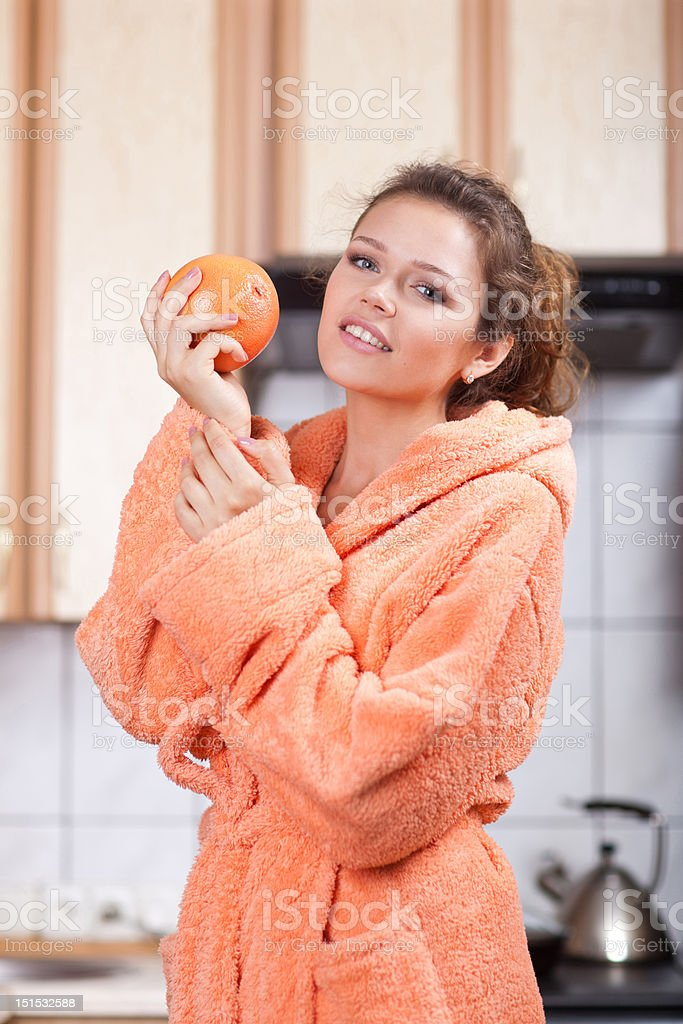 pretty woman in the kitchen stock photo