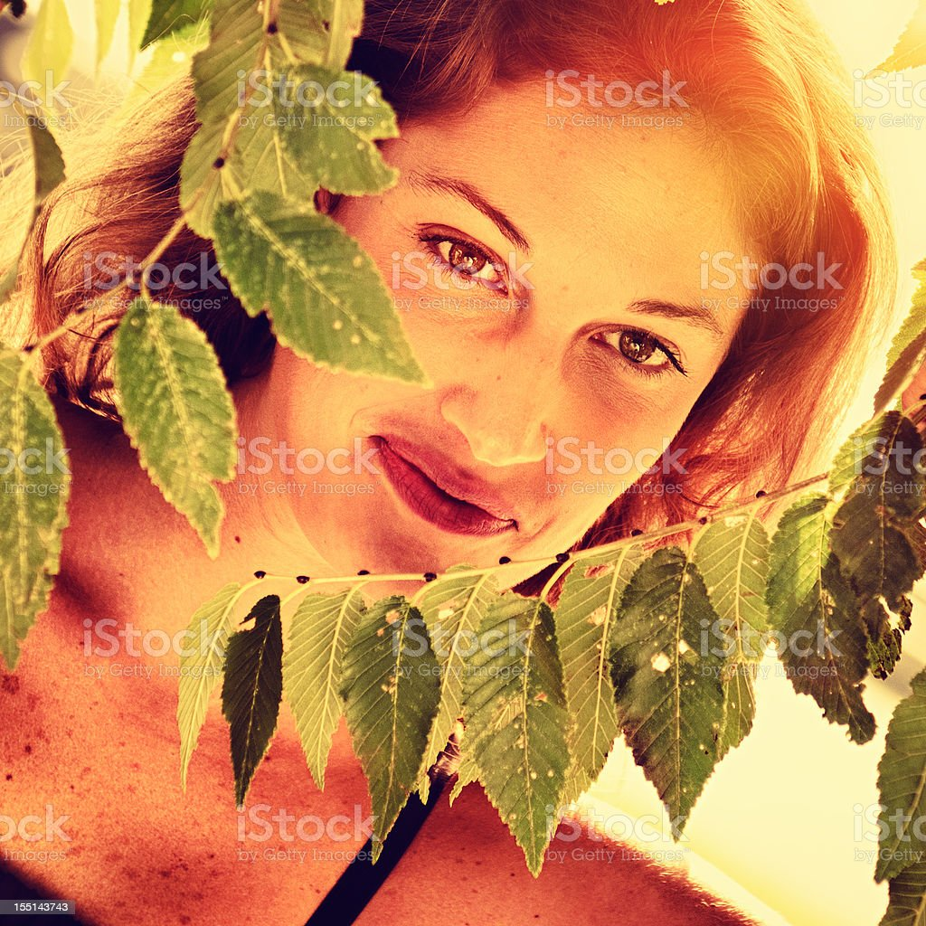Pretty woman in the wild nature at sunset royalty-free stock photo