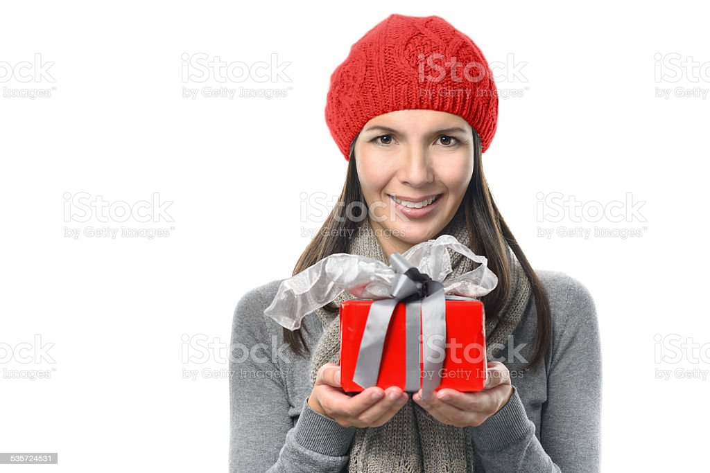Pretty Woman in Winter Outfit Holding Present stock photo