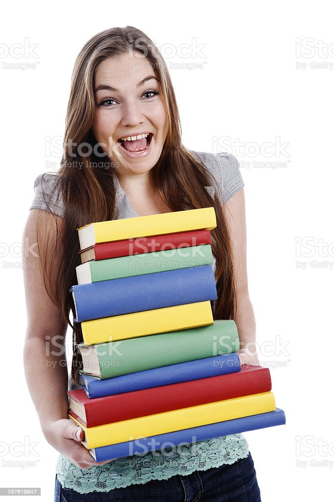 Pretty  woman laughs as she nearly drops stack of books royalty-free stock photo
