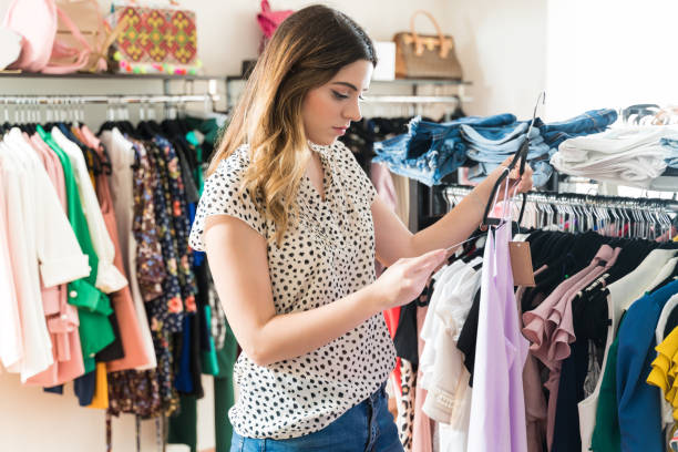 Pretty Woman Looking At Apparel Label In Store stock photo