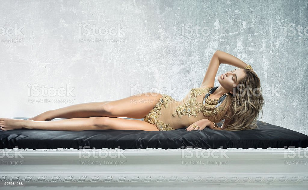 Pretty woman lying in the bed stock photo