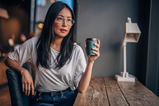 Pretty woman on a coffee break