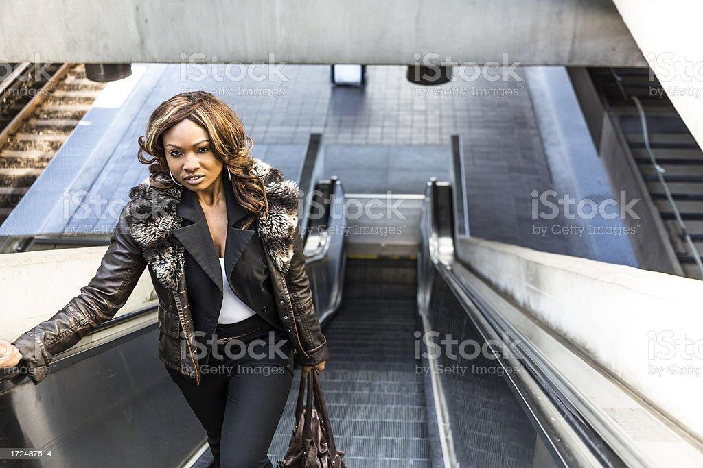 Pretty Woman on a Train Platform Escalator royalty-free stock photo