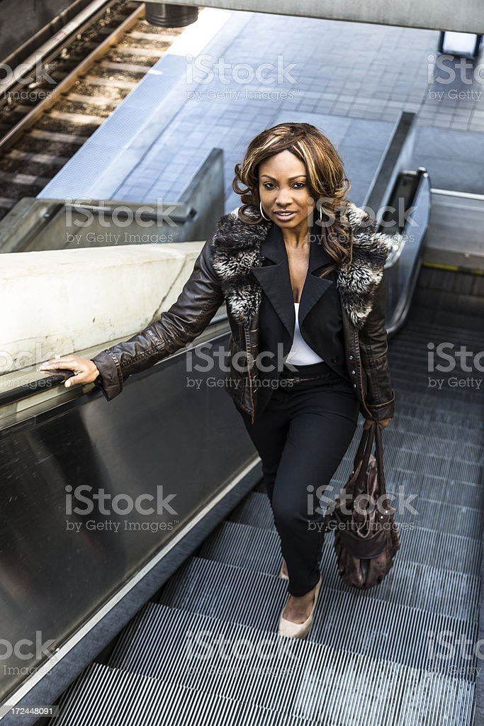 Pretty Woman on a Train Platform Escalator royalty-free stock photo