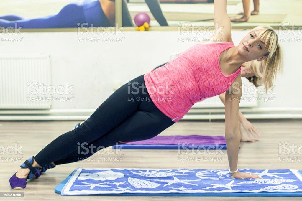 Pretty woman on fitness training doing plank stock photo