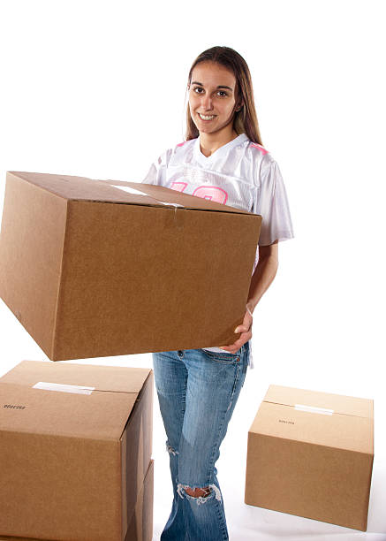 Pretty woman packing move new house or working warehouse stock photo