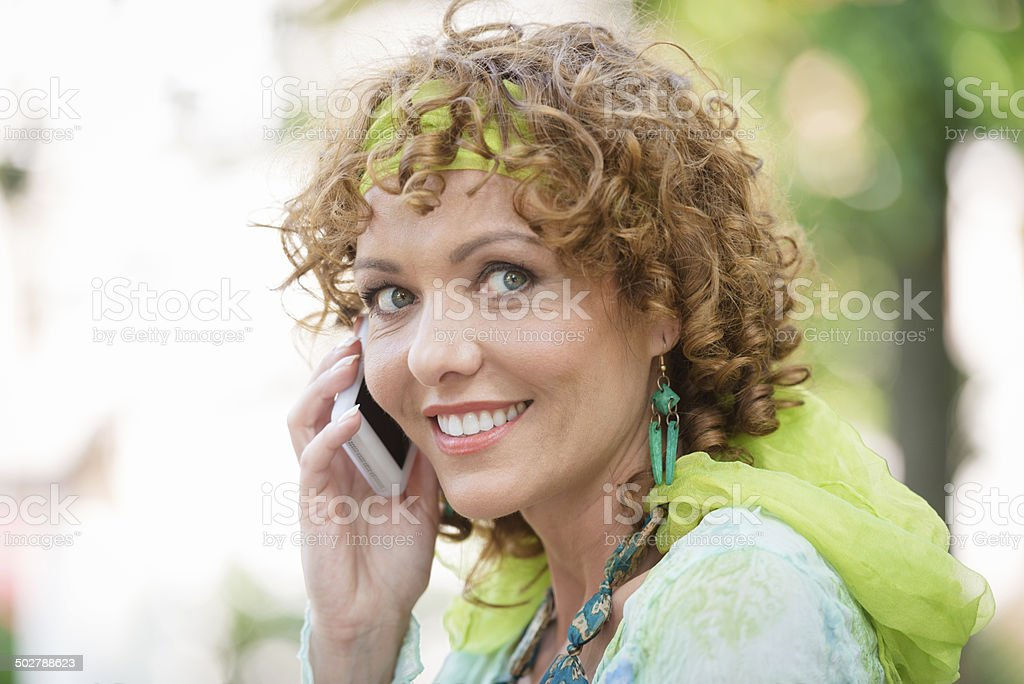 Pretty Woman Phoning in City Park, Italy, Europe stock photo