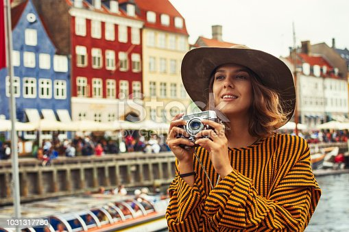 Young pretty woman in Copenhagen taking pictures