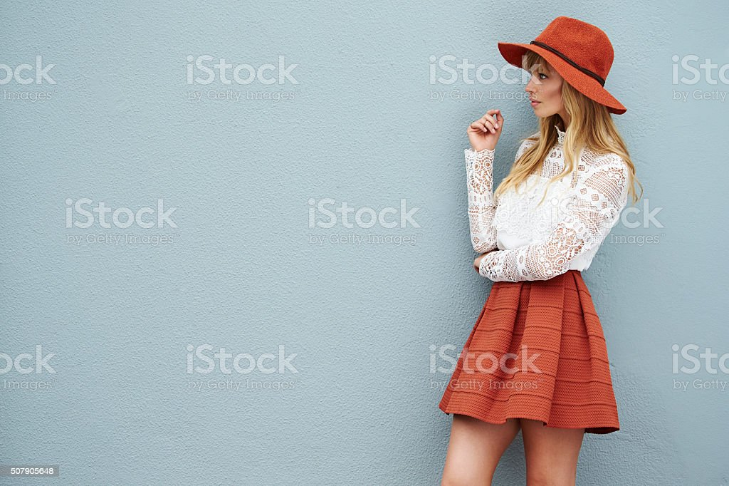 Pretty woman in cool clothes, looking away