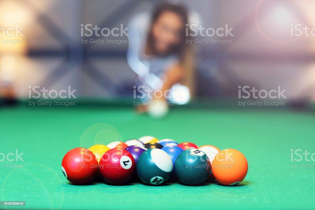 Pretty woman playing billards stock photo