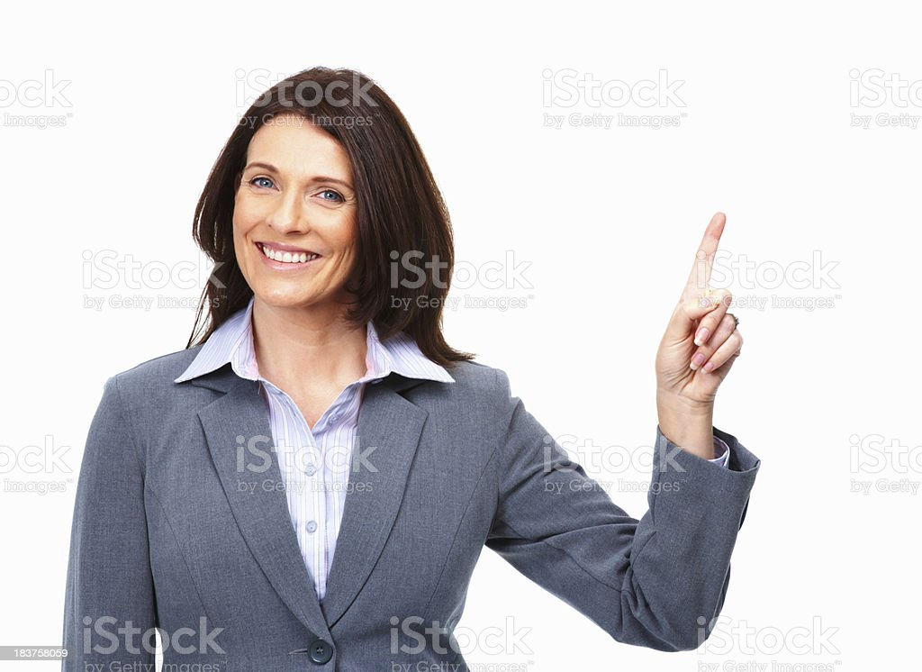 Pretty woman pointing up on white background stock photo