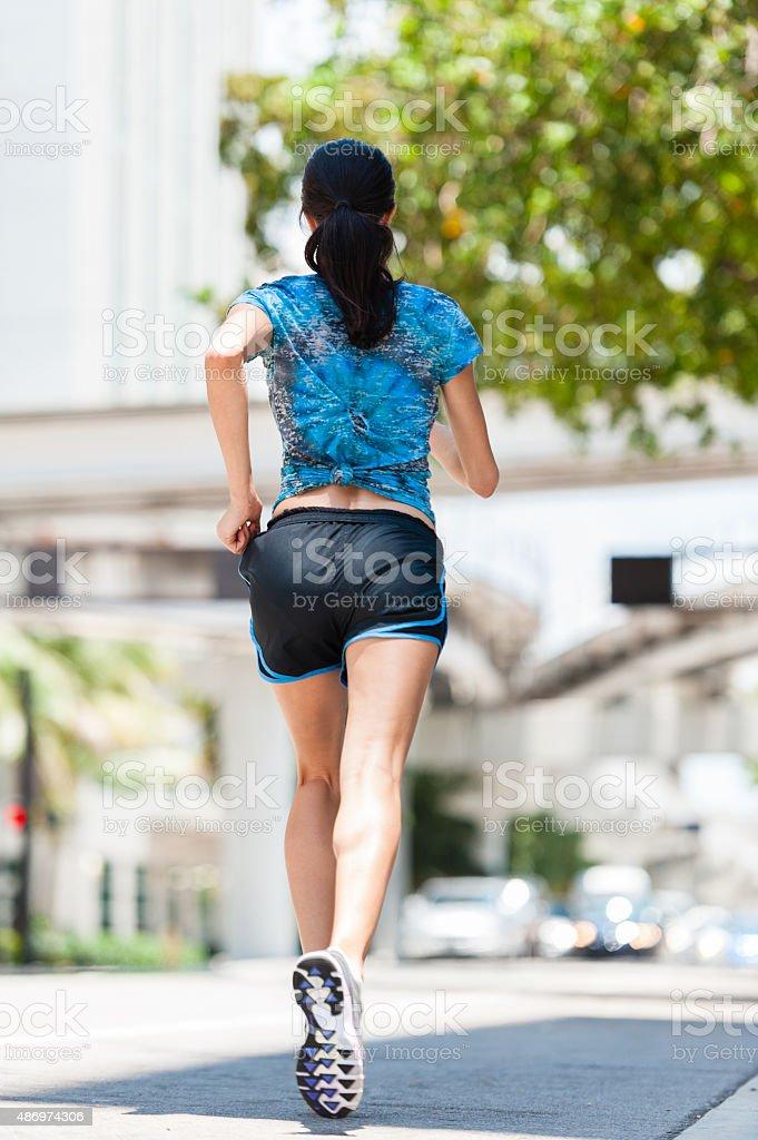 Pretty woman running stock photo