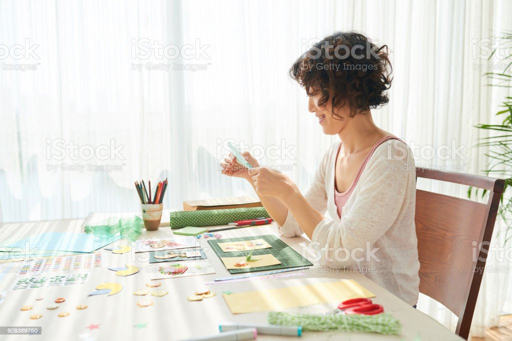 Pretty Woman Scrapbooking at Home stock photo