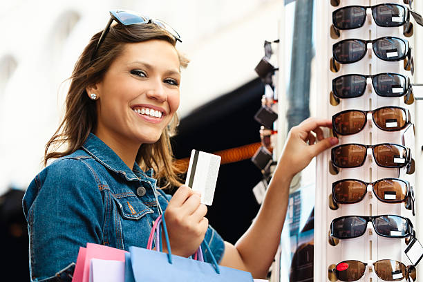 pretty woman shopping sunglasses - gift voucher or card stock photos and pictures