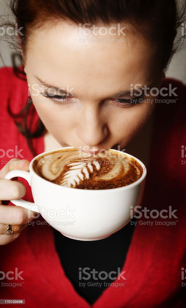 Pretty woman sipping a coffee royalty-free stock photo