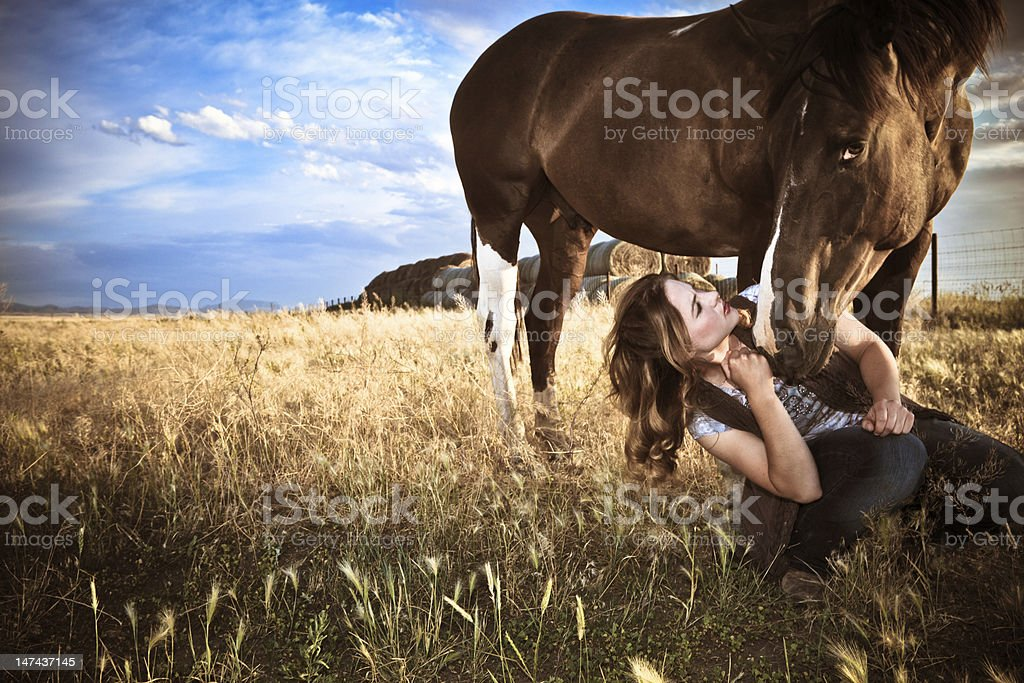 Pretty Woman Sitting With Horse stock photo