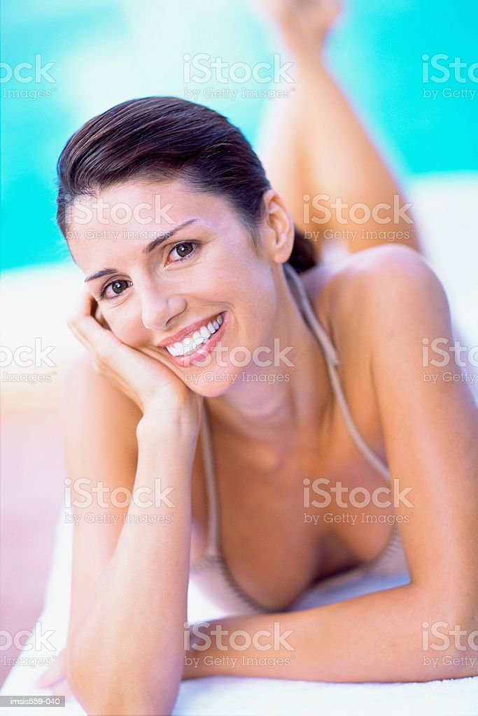 Pretty woman smiling at camera royalty free stockfoto