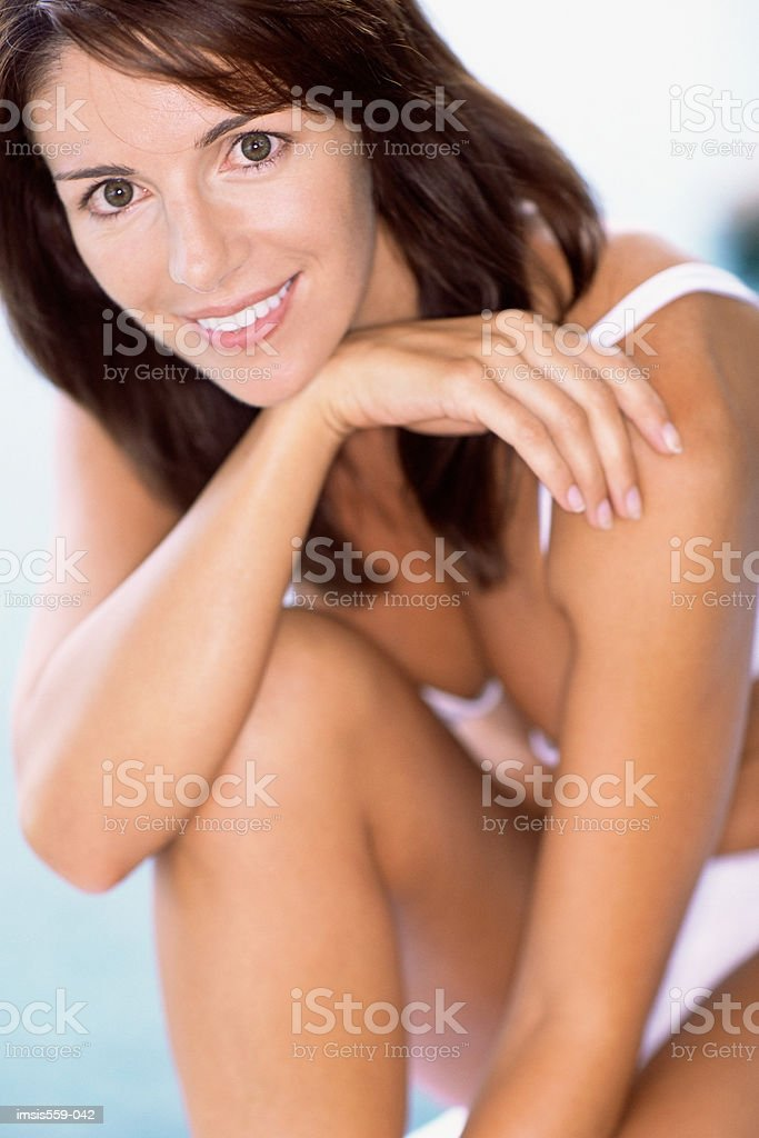 Pretty woman smiling at camera royalty-free stock photo