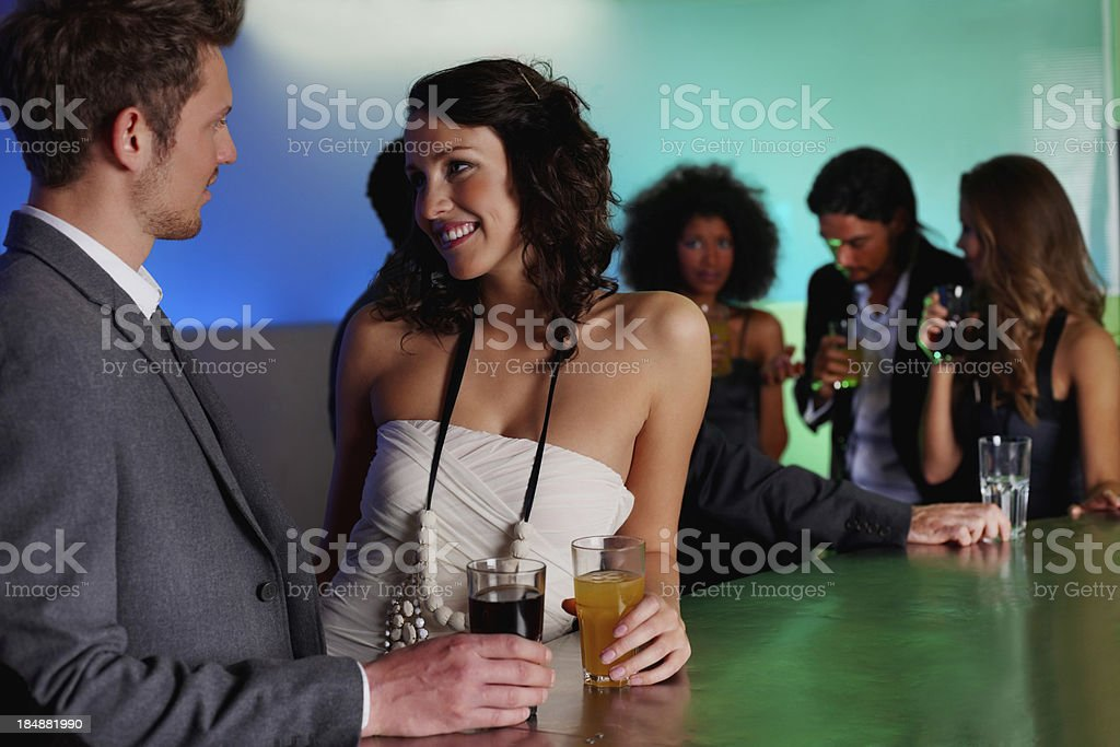 Pretty woman smiling at casual businessman royalty-free stock photo