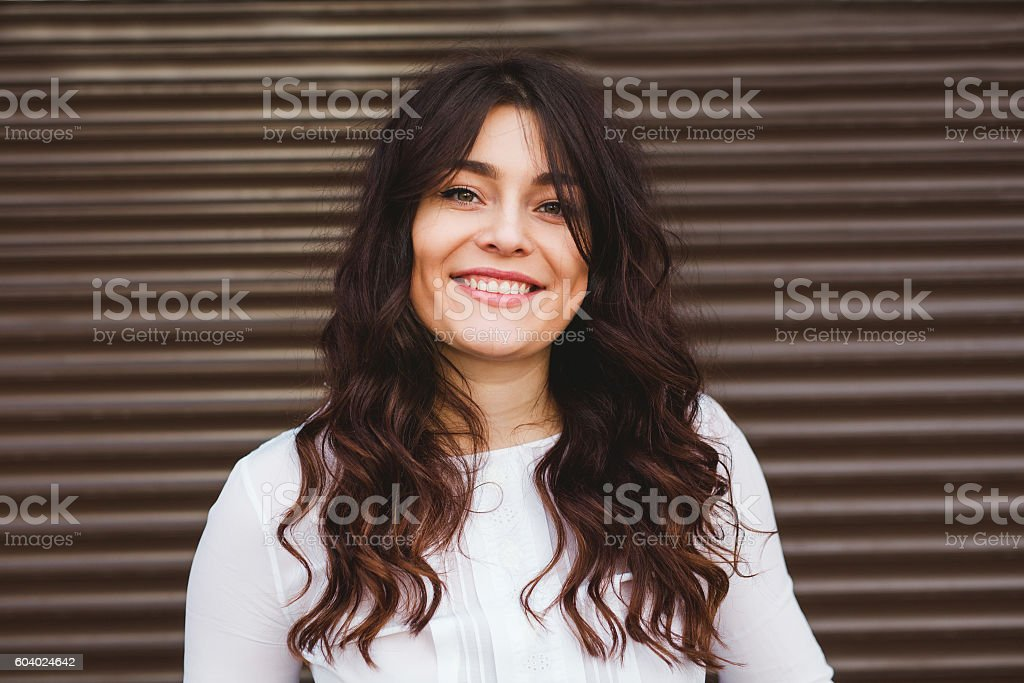Pretty plus size woman smiling with perfect smile stock photo