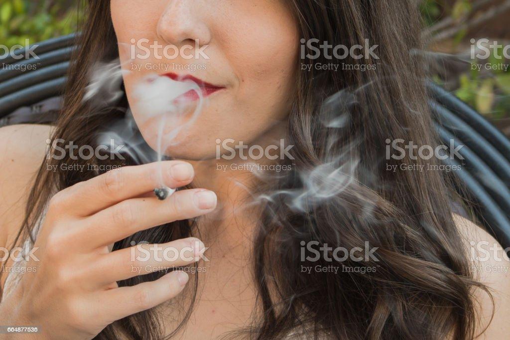 Pretty woman smoking the ganja stock photo