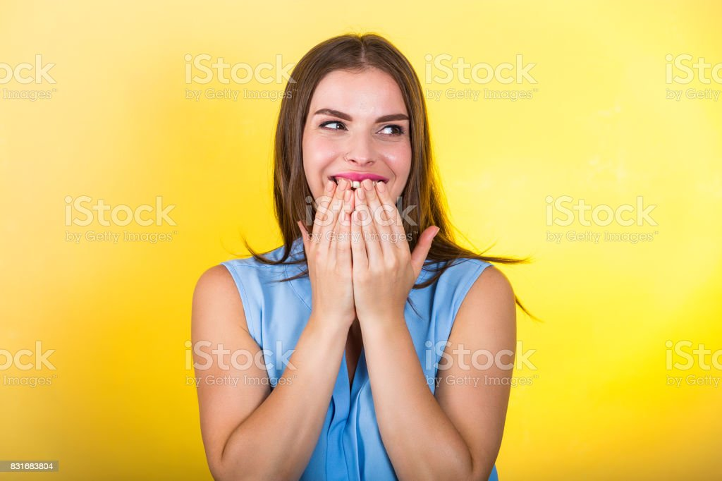 Pretty woman standing against bright background stock photo