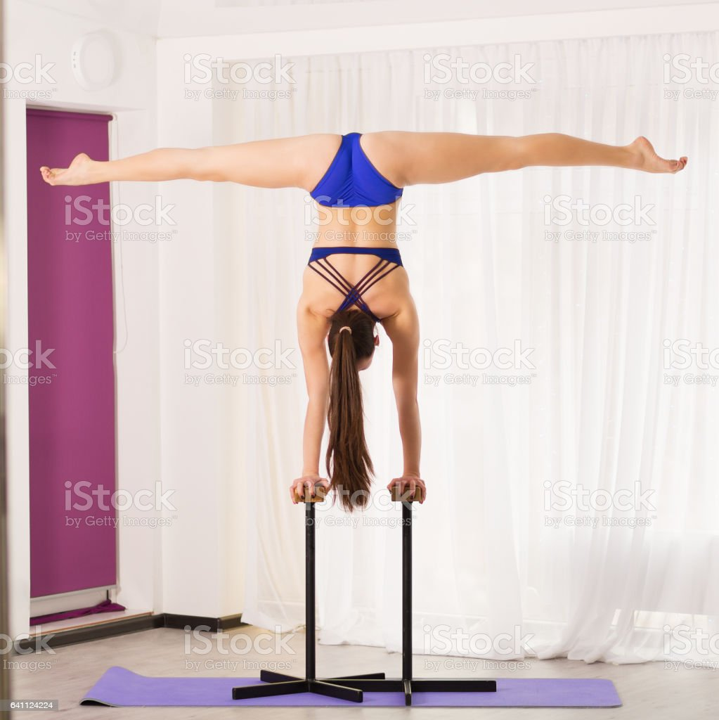 Pretty woman stretching in the studio stock photo