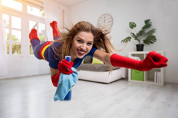 pretty woman superhero flying through the room with a mop - dona de casa - fotografias e filmes do acervo