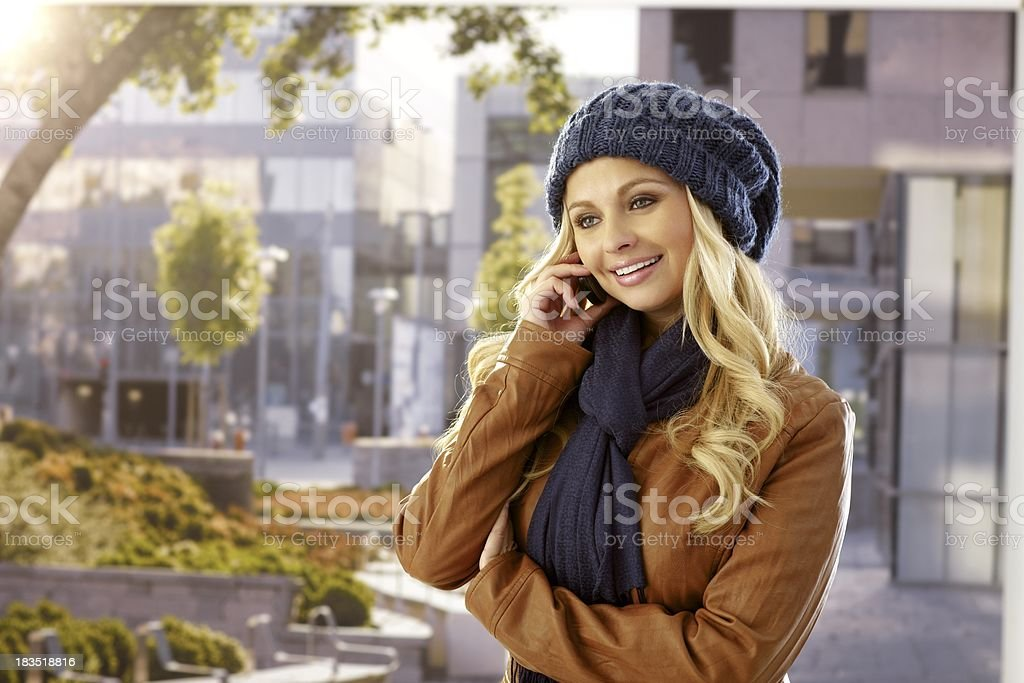 Pretty woman talking on mobile outdoors royalty-free stock photo