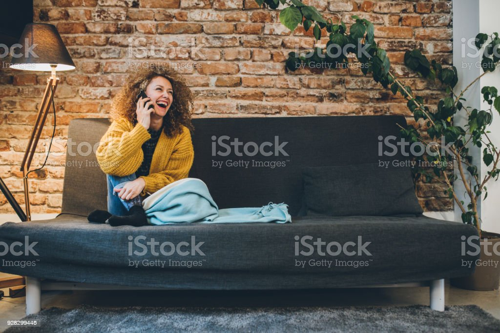 Pretty woman talking on the phone stock photo