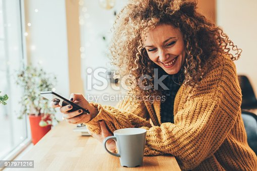 istock Pretty woman texting on the phone 917971216
