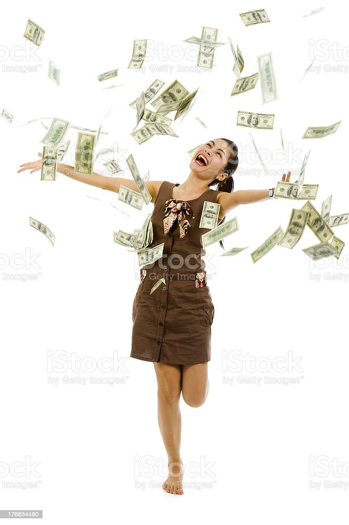pretty woman throwing money stock photo