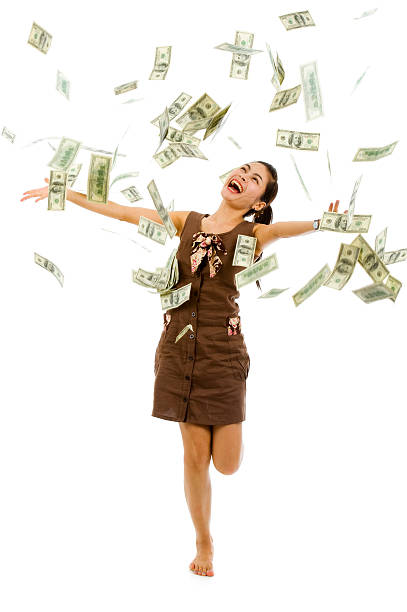 pretty woman throwing money - throw money away stock pictures, royalty-free photos & images
