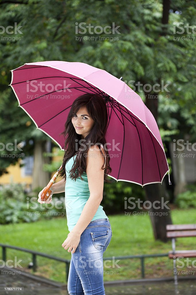 Pretty Woman Under Big Umbrella In The Park royalty-free stock photo