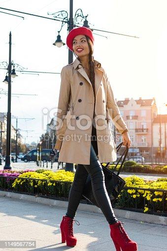 Pretty asian woman walking down the streets