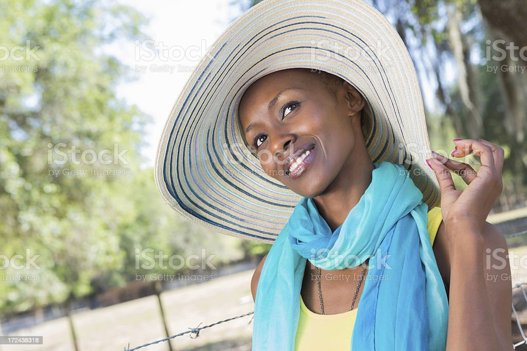 Pretty woman wearing large hat looking up outdoors. royalty-free stock photo