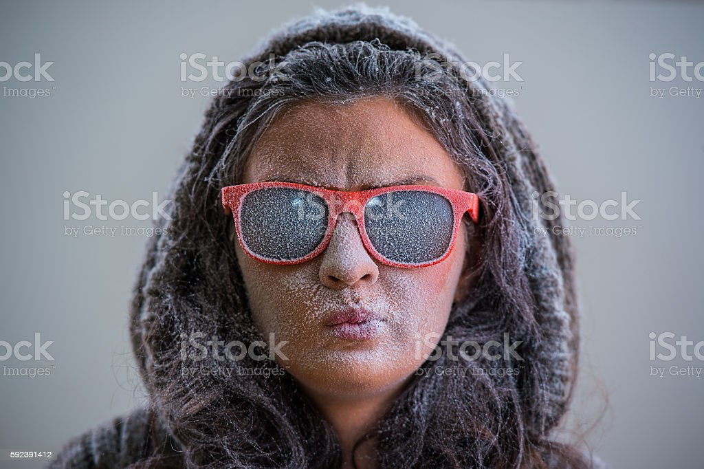 Pretty woman wearing winter outfit and sunglasses stock photo