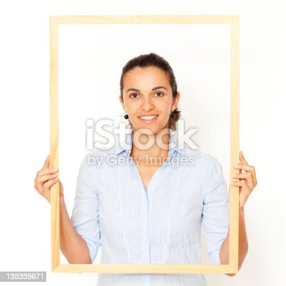 istock Pretty woman with a big yellow frame 135359671