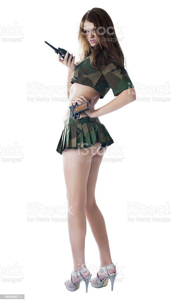 Pretty woman with a gun stock photo