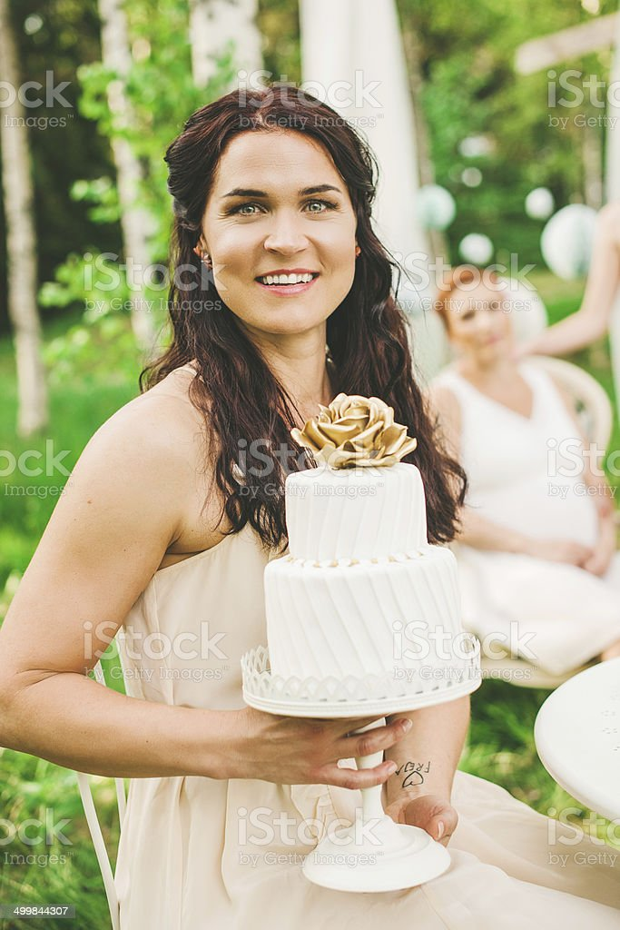 Pretty woman with beautiful cake at a garden party royalty-free stock photo